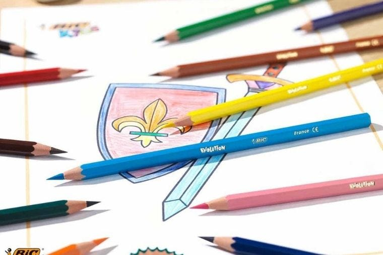 A selection of BiC eco-friendly colouring pencils lay on top of a colouring in book
