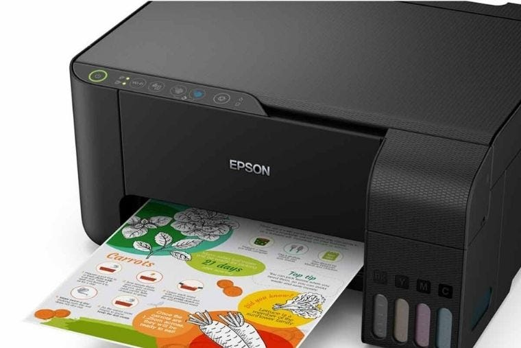 Close up of black Epson EcoTank printer, a colour document is being printed with it.